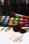 stock photo of makeup artist  - A sketch of makeup face on a paper with makeup accessories - JPG
