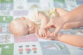 Young Dad Holds The Hand Of His Newborn Baby. Hand In Hand. Little Baby Hand In Dad S Big Hands. Tog poster