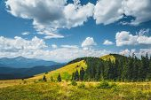 Azure sky background with white fluffy clouds in the sunny day. Location place Carpathian mountains, poster