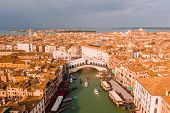 Aerial Panoramic View Of Famous Canal Grande And Famous Rialto Bridge At Sunset In Venice, Italy. poster