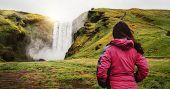 Traveler Travel To Skogafoss Waterfall In Iceland. poster