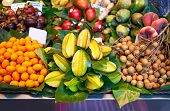 Fresh Fruits In Market. Exotic Fresh Fruits On A Market, Papaya, Dragon Fruit, Passion Fruit. poster