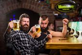 Alcohol Drinks. Friends Relaxing In Pub With Beer. Refreshing Beer Concept. Men Drinking Beer Togeth poster