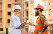Construction Project Inspecting. Safety Inspector Concept. Woman Inspector And Bearded Brutal Builde poster