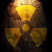 stock photo of radium  - sign of radiation on the grunge wall - JPG