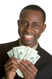 stock photo of holding money  - Happy young African American man holding money - JPG