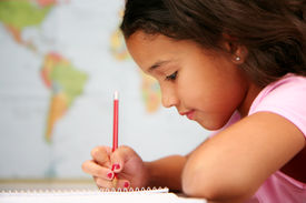image of school child  - Child at school writing with a pencil - JPG