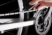 picture of mountain chain  - Bicycle chain oiling. Studio shot on black backgorund