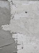 stock photo of stippling  - Construction worker is tiling at home tile floor adhesive Abstract plaster stucco wall - JPG