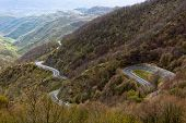 image of long winding road  - Long Winding Road Through Italian Mountains Landscape. View from above