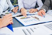 stock photo of graphs  - Business people team work group during conference discussing financial diagram - JPG