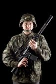image of m16  - Soldier staying with m16 in studio - JPG