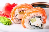 stock photo of soy sauce  - Sushi soy and ginger with chopsticks on a white plate - JPG