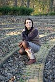 image of leg warmer  - Pretty woman in amphitheater in autumn park - JPG