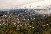 stock photo of luzon  - Scenic landscape showing thousands of homes and buildings crowded on hillsides of the Cordillera mountains in the Benguet Province of Luzon Island Philippines - JPG
