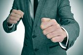 stock photo of fist  - man wearing a suit with ready to fight with his fists - JPG