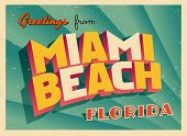 Vintage Touristic Greeting Card - Miami Beach, Florida - Vector EPS10. Grunge effects can be easily