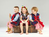 foto of national costume  - Smiling kids wearing national costume - JPG
