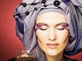 stock photo of turban  - Romantic portrait of young woman in violet turban and black beads - JPG