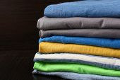 Stack of colorful clothes, isolated on black