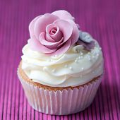 stock photo of sugarpaste  - Cupcake decorated with a purple sugar rose - JPG