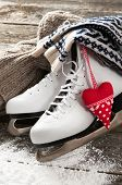 foto of skate board  - White ice skates on old wooden boards