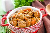 pic of stew pot  - Goulash in a pot on a wooden table