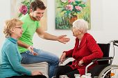 stock photo of grandma  - Young man talking with his grandma and her friend - JPG