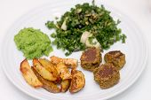 Baked Potatoes, Falafels, Pea Mousse And Salad On White Plate