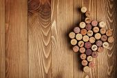 stock photo of bordeaux  - Grape shaped wine corks on wooden table background with copy space - JPG