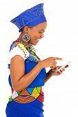 image of zulu  - gorgeous black woman using smart phone on white background - JPG