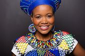 foto of zulu  - close up portrait of african zulu girl wearing traditional attire - JPG
