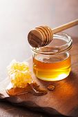 picture of honeycomb  - honeycomb dipper and honey in jar on wooden background  - JPG