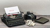 foto of typewriter  - retro typewriter and vintage photo camera on wooden table - JPG