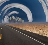 stock photo of surrealism  - Gleaming city in desert with surreal clouds - JPG