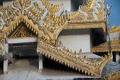 picture of muni  - Myanmar art on roof Pagoda of Maha Muni temple in Mandalay city - JPG