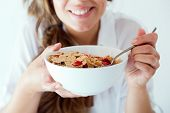 picture of cereal bowl  - Portrait of young woman in underwear eating cereals - JPG