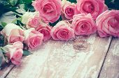stock photo of toned  - Bouquet of pink roses on old wooden board background vintage toning - JPG