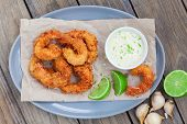 stock photo of shrimp  - Coconut shrimp with garlic aioli and lime