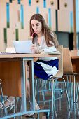 picture of canteen  - Girl studying with ipad in the University canteen - JPG