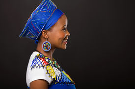 picture of zulu  - side view of young african zulu woman on black background - JPG