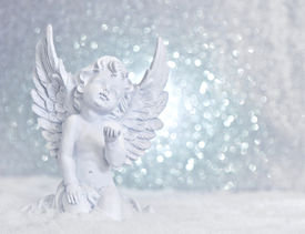foto of christmas angel  - little white guardian angel in snow on shiny lights background - JPG
