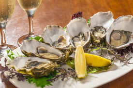foto of oyster shell  - Fresh oysters with lemon wedge and champagne - JPG