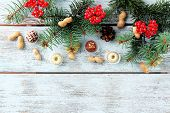 picture of hazelnut tree  - Chocolates with hazelnuts and sprigs of Christmas tree on color wooden background - JPG