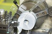 stock photo of machine  - drilling and turning mold part by turning and lathe machine - JPG