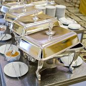 picture of buffet  - Buffet heated trays ready for service decorate for food - JPG