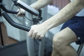 picture of day care center  - Young man on exercise bicycle in physiotherapy gym fitness center clinic. ** Note: Visible grain at 100%, best at smaller sizes - JPG