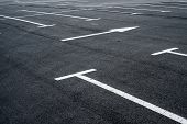 stock photo of paved road  - Asphalt surface of the empty parking with white road marking lines - JPG