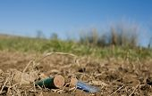 picture of shotgun  - Rusty spent shotgun cartridges on a medow floor - JPG