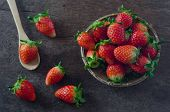 stock photo of wooden basket  - Fresh strawberries on basket over old wooden background - JPG